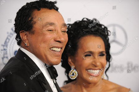 Frances Gladney, right, and Smokey Robinson arrive at The Carousel of Hope at The Beverly Hilton Hotel, in Beverly Hills