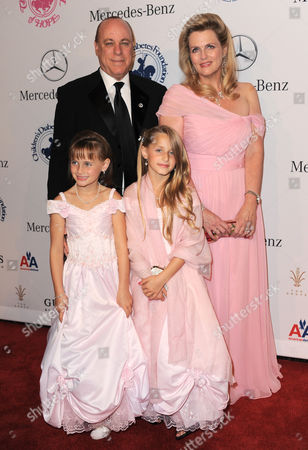 Stock Photo of Nancy Davis (top R) with husband Ken Rickel and daughters Isabella Rickel and Ariana Rickel arrive at The Carousel of Hope at The Beverly Hilton Hotel, in Beverly Hills