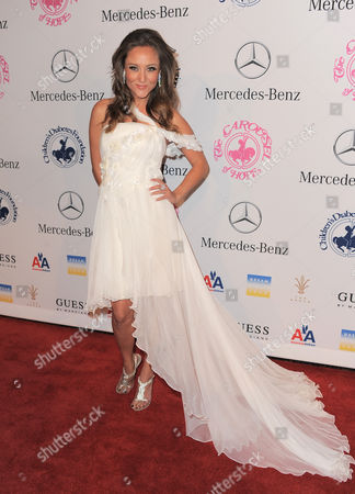 Lauren C. Mayhew arrives at The Carousel of Hope at The Beverly Hilton Hotel, in Beverly Hills