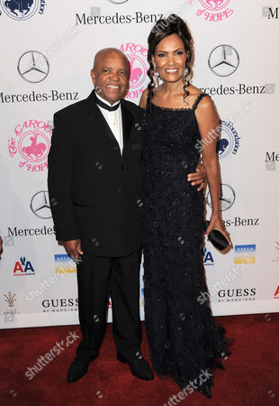 Berry Gordy and Eskedar Gobeze arrive at The Carousel of Hope at The Beverly Hilton Hotel, in Beverly Hills