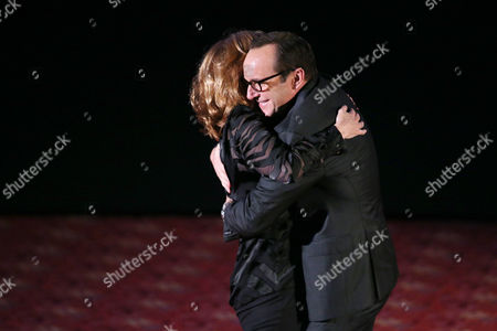 "Host Carol Leifer, left, hugs Clark Gregg on stage at ""The Hollywood Reporter's Key Art Awards"" Powered by Clio, in Los Angeles"