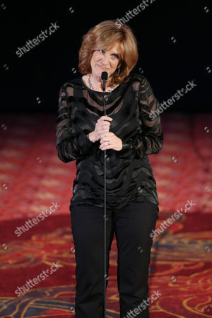 "Host Carol Leifer speaks on stage at ""The Hollywood Reporter's Key Art Awards"" Powered by Clio, in Los Angeles"