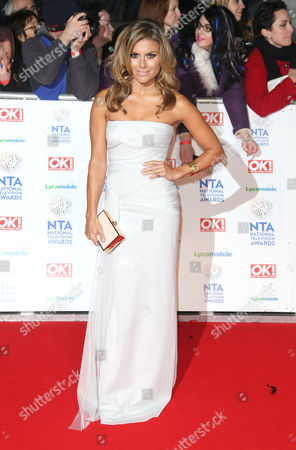 TV Personality Fernanda Lima poses for photographers at the National Television Awards, held at the O2 Arena, London, on