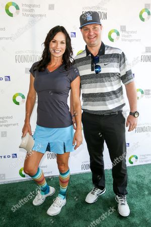 Debbe Dunning, left, and Zachery Ty Bryan arrive at The Screen Actors Guild Foundation 6th Annual Los Angeles Golf Classic, in Burbank, Calif