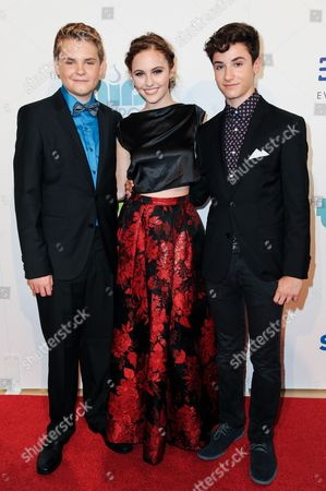 From left, Reese Hartwig, Ella Wahlestedt, and Teo Halm arrive at The Thirst Project's Annual Gala held at the Beverly Hilton Hotel, in Los Angeles