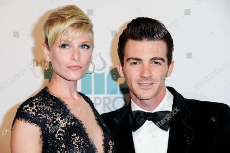 Drake Bell, left, and Paydin Lopachin arrive at The Thirst Project's Annual Gala held at the Beverly Hilton Hotel, in Los Angeles
