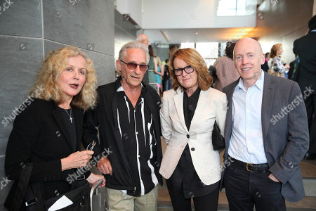 Stock Photo of From left, Danna Ruscha, artist Ed Ruscha, Hammer Museum director Ann Philbin and Marc Selwyn pose during The Un-Private Collection: Eric Fischl and Steve Martin, an art talk presented by The Broad museum and held at The Broad Stage, in Santa Monica, Calif