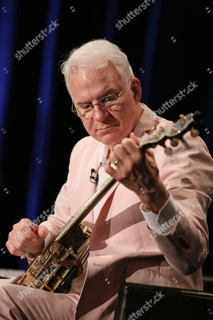 Steve Martin plays the banjo during The Un-Private Collection: Eric Fischl and Steve Martin, an art talk presented by The Broad museum and held at The Broad Stage, in Santa Monica, Calif