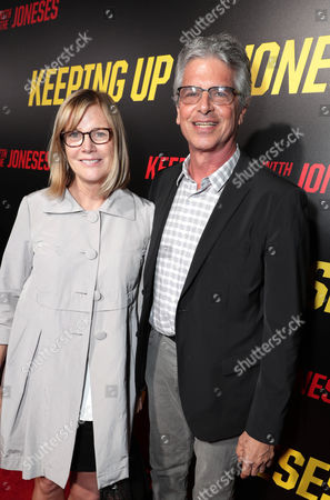 "Producer Laurie MacDonald and Producer Walter F. Parkes seen at Twentieth Century Fox ""Keeping Up with the Joneses"" red carpet event, in Los Angeles"