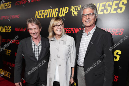 "Martin Short, Producer Laurie MacDonald and Producer Walter F. Parkes seen at Twentieth Century Fox ""Keeping Up with the Joneses"" red carpet event, in Los Angeles"