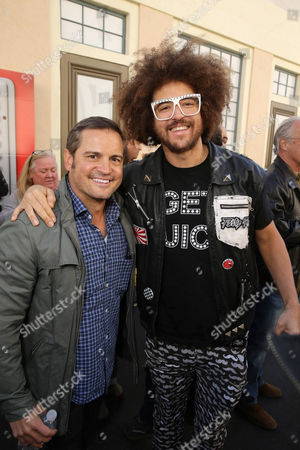 Stock Image of Director Walt Becker and Redfoo seen at Twentieth Century Fox Friends and Family screening of 'Alvin and The Chipmunks: The Road Trip' at Zanuck Theatre, in Los Angeles, CA