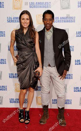 Jacqueline Staph, left, and Orlando Jones arrive at Twentieth Century Fox Television Distribution's 2013 LA Screenings Lot Party on in Los Angeles, California