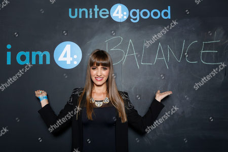 "Andrea Minski declares what she stands for at the Celebration of Local Heroes during unite4:good Day of Unity - Miami joining volunteers, celebrities and community leaders at the Ice Palace Film Studios on Monday, January, 20, 2014 in Miami, FL. unite4:good is the global movement for humanity whose mission is to inspire charitable action globally. With the support of local organizations and volunteers, the unite4:good movement launched in Miami and consisted in a variety of events and activities â?"" ranging from painting murals in Overtown to organizing donated items at the Chapman warehouse helping homeless families. Miami-Dade County issued a proclamation deeming January, 20, unite4:good Day"