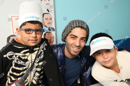 Stock Picture of Actor Jason Canela poses with kids at Amigos For Kids Reading Enrichment Program during unite4:good Day of Unity - Miami on Monday, January, 20, 2014 in Miami, FL. Unite4:good is the global movement for humanity whose mission is to inspire charitable action globally. Miami-Dade County issued a proclamation deeming January 20th unite4:good Day. Closing the day's activities with a celebration featuring award-winning recording artist Flo Rida