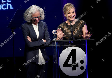 Dr. Jane Aronson, left, presents Amy Poehler with the unity award at unite4:good and Variety's 2nd annual unite4:humanity at the Beverly Hilton Hotel on Thursday, Feb.19, 2015, in Beverly Hills, Calif
