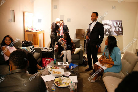 John Legend stands backstage along with Ana Yanez-Correa, far left, Adam Foss, rear in chair, Courtney Kemp Aghoh, right, and moderator Baratunde Thurston, front left, before they participate in the Television Academy's UNLOCK OUR POTENTIAL member event at the Academy's Wolf Theater and Saban Media center on in Los Angeles