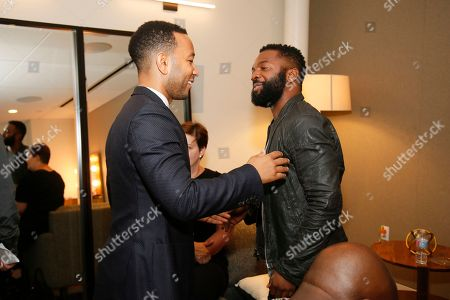John Legend and Moderator Baratunde Thurston greet each other backstage as they participate in the Television Academy's UNLOCK OUR POTENTIAL member event at the Academy's Wolf Theater and Saban Media center on in Los Angeles