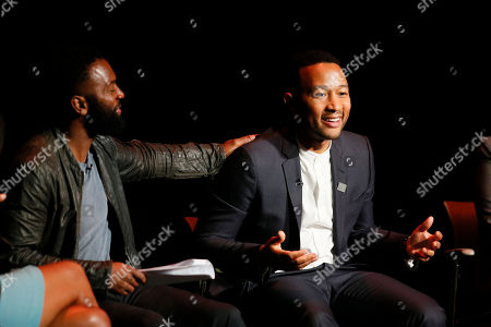 Moderator Baratunde Thurston, left, and John Legend participate in the Television Academy's UNLOCK OUR POTENTIAL member event at the Academy's Wolf Theater and Saban Media center on in Los Angeles