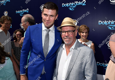 """Austin Stowell and Writer/Director Charles Martin Smith seen at the Los Angeles Premiere of Warner Bros. Pictures' and Alcon Entertainment's """"Dolphin Tale 2"""" held at the Regency Village Theatre, Westwood, Calif"""