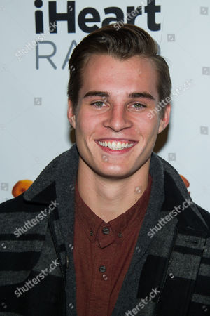Marcus Johns poses in the Z100 Jingle Ball press room at Madison Square Garden, in New York