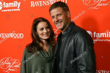 "Actors Laura Leighton and husband / actor Doug Savant arrive at the ""Pretty Little Liars"" screening of a special Halloween episode at the Hollywood Forever Cemetery on in Los Angeles"