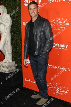"Actor Doug Savant arrives at the ""Pretty Little Liars"" screening of a special Halloween episode at the Hollywood Forever Cemetery on in Los Angeles"