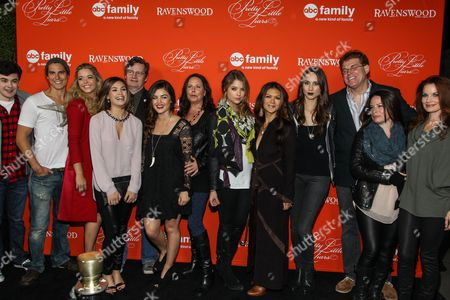 "From left, actors Brendan Robinson, Sean Faris, Sasha Pieterse, Nicole Gale Anderson, executive producer Joseph Dougherty, Lucy Hale, executive producer I. Marlene King, Ashley Benson, Nia Peeples, Troian Bellisario, executive producer Oliver Goldstick, Holly Marie Combs, and Laura Leighton arrive at the ""Pretty Little Liars"" screening of a special Halloween episode at the Hollywood Forever Cemetery on in Los Angeles"