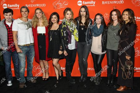 "From left, actors Brendan Robinson, Sean Faris, Sasha Pieterse, Lucy Hale, Ashley Benson, Troian Bellisario, Holly Marie Combs, Laura Leighton, and Nia Peeples arrive at the ""Pretty Little Liars"" screening of a special Halloween episode at the Hollywood Forever Cemetery on in Los Angeles"