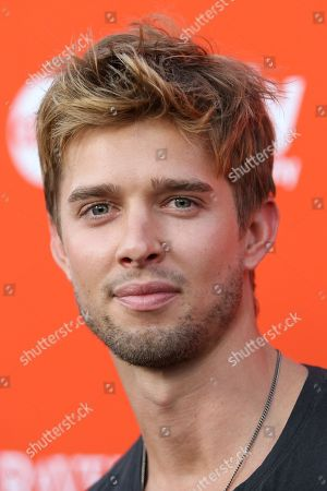 "Actor Drew Van Acker arrives at the ""Pretty Little Liars"" screening of a special Halloween episode at the Hollywood Forever Cemetery on in Los Angeles"