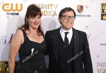 Janet Grillo, left, and David O. Russell arrive at the 19th annual Critics' Choice Movie Awards at the Barker Hangar, in Santa Monica, Calif