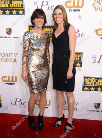 Kristine Belson and Jane Hartwell arrive at the 19th annual Critics' Choice Movie Awards at the Barker Hangar, in Santa Monica, Calif