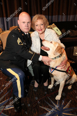 From left, Sgt. 1st Class Chuck Shuck, Actress Betty White and The 2012 American Hero Dog Gabe pose during 2012 American Humane Association Hero Dog Awards held at the Beverly Hilton Hotel, in Los Angeles, Calif