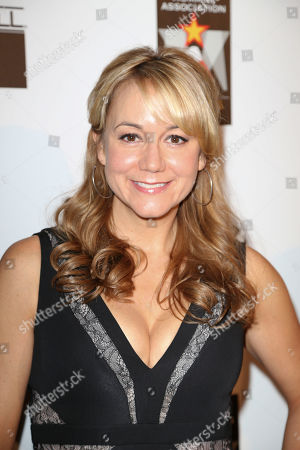 Actress Megyn Price arrives during 2012 American Humane Association Hero Dog Awards held at the Beverly Hilton Hotel, in Los Angeles, Calif