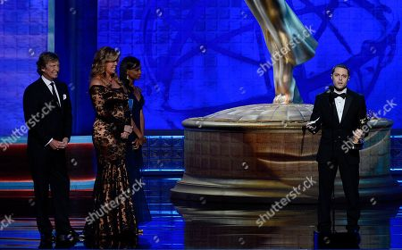 SEPTEMBER 15: (L-R) Nigel Lythgoe and Mary Murphy with Joshua Bergasse as he accepts the award for Outstanding Choreography onstage at the Academy of Television Arts & Sciences 64th Primetime Creative Arts Emmy Awards at Nokia Theatre L.A. Live on in Los Angeles, California