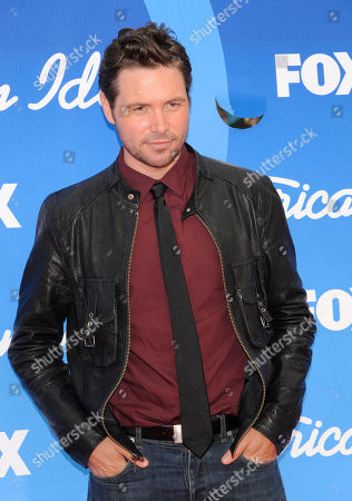 """Michael Johns arrives at the """"American Idol"""" finale at the Nokia Theatre at L.A. Live, in Los Angeles"""
