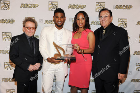 From left, ASCAP President Paul Williams, Usher, winner of ASCAP's Golden Note Award, Nicole George-Middleton, Vice President of ASCAP Rhythm & Soul/Urban Membership, and ASCAP CEO John LoFrumento pose backstage at the 26th Annual ASCAP Rhythm & Soul Music Awards, in Beverly Hills, Calif