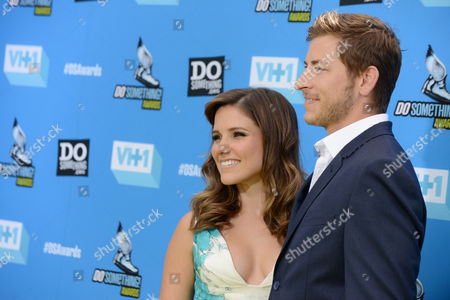 Stock Picture of Sophia Bush, left, and Dan Fredinburg arrive at the Do Something Awards at the Avalon, in Los Angeles