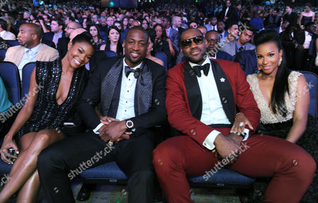 Gabrielle Union, left, and Dwyane Wade, center, LeBron James and Savannah Brinson are seen in the audience at the ESPY Awards, at the Nokia Theater in Los Angeles
