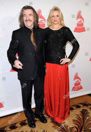 Stock Photo of Latin Recording Academy Chairman of the Board of Trustees Luis Cobos, left, and Patricia Cobos, arrive at the Latin Recording Academy Lifetime Achievement and Trustees awards, at the Four Seasons Hotel in Las Vegas