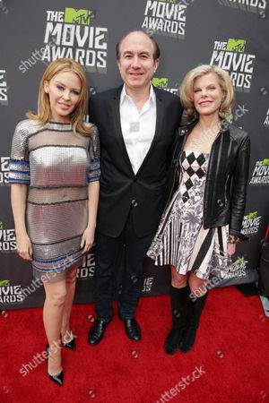 Kylie Minogue, Viacom's Philippe Dauman and wife Deborah Dauman arrive at the MTV Movie Awards in Sony Pictures Studio Lot in Culver City, Calif., on