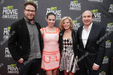 Seth Rogan, Lauren Miller, Deborah Dauman and Viacom's Philippe Dauman arrive at the MTV Movie Awards in Sony Pictures Studio Lot in Culver City, Calif., on