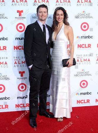 Stock Image of David J. Phillips and Mia Mastroianni arrive at the NCLR ALMA Awards at the Pasadena Civic Auditorium, in Pasadena, Calif