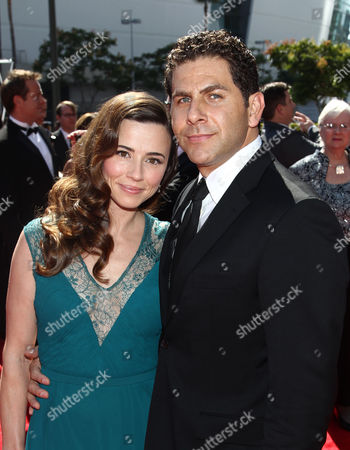 From left, Linda Cardellini and Steve Rodriguez arrive at the 2013 Primetime Creative Arts Emmy Awards, on at Nokia Theatre L.A. Live, in Los Angeles, Calif
