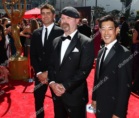 From left, Tory Belleci, Jamie Hyneman and Grant Imahara arrive at the 2013 Primetime Creative Arts Emmy Awards, on at Nokia Theatre L.A. Live, in Los Angeles, Calif