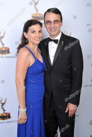 Gina Morrone, left, and Frank Morrone pose for a portrait at the 2013 Primetime Creative Arts Emmy Awards, on at Nokia Theatre L.A. Live, in Los Angeles, Calif