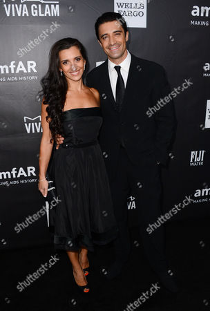 Gilles Marini, left, and Carole Marini arrive at the 2014 amfAR Inspiration Gala at Milk Studios on Wednesday, Oct. 29, in Los Angeles