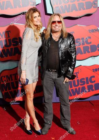 Rain Andreani and Vince Neil arrives at the CMT Music Awards at Bridgestone Arena, in Nashville,Tenn