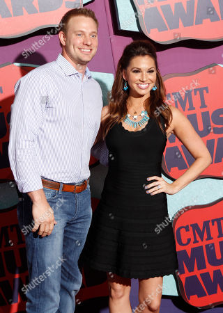 Stock Picture of Tye Strickland, left, and Melissa Rycroft arrive at the CMT Music Awards at Bridgestone Arena, in Nashville, Tenn