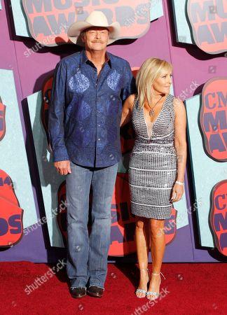 Stock Picture of Alan Jackson, left, and Denise Jackson arrive at the CMT Music Awards at Bridgestone Arena, in Nashville, Tenn