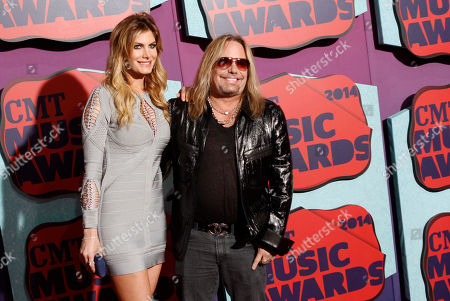 Rain Andreani and Vince Neil arrive at the CMT Music Awards at Bridgestone Arena, in Nashville,Tenn